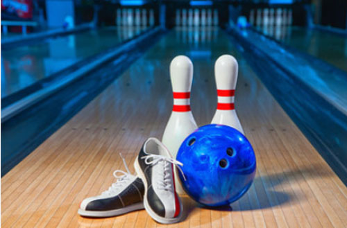 bowling pins and a ball and shoes